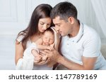 woman and man holding a newborn.... | Shutterstock . vector #1147789169