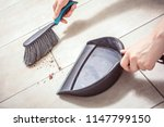 female hands sweeping dust with ... | Shutterstock . vector #1147799150