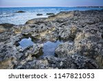 calm morning sea and stony... | Shutterstock . vector #1147821053