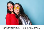 like a sisters  two beautiful... | Shutterstock . vector #1147825919