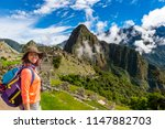 a woman trek to machu picchu ... | Shutterstock . vector #1147882703