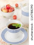 black tea with mint and apples - stock photo