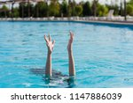 woman and two hadns up in pool | Shutterstock . vector #1147886039