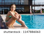 young girl posing near swimming ... | Shutterstock . vector #1147886063