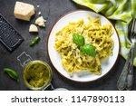 tagliatelle pasta with pesto... | Shutterstock . vector #1147890113