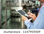 senior engineer inspecting...   Shutterstock . vector #1147905509