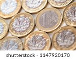stack of euro coins and new... | Shutterstock . vector #1147920170