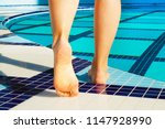 close up of barefoot young... | Shutterstock . vector #1147928990