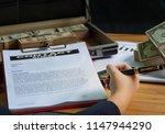 businessmen are signing... | Shutterstock . vector #1147944290
