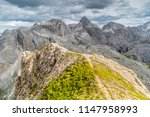 panoramic view of a climber... | Shutterstock . vector #1147958993