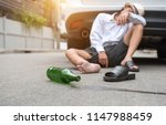 man drinking alcohol while... | Shutterstock . vector #1147988459