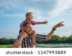 happy young father holds his...   Shutterstock . vector #1147993889