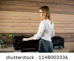 young business woman working in ... | Shutterstock . vector #1148003336