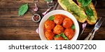 meatballs in tomato sauce and... | Shutterstock . vector #1148007200