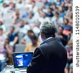 speaker giving a talk on... | Shutterstock . vector #1148010539