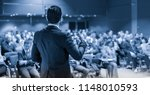 speaker giving a talk on... | Shutterstock . vector #1148010593
