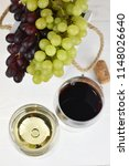 two glasses of red and white... | Shutterstock . vector #1148026640