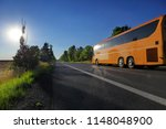 bus on the road at sunset   Shutterstock . vector #1148048900