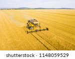 aerial view of harvest. combine ... | Shutterstock . vector #1148059529