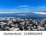 Small photo of Landscape of lumps of melting ice on lake in spring