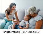 mother introduces her baby to... | Shutterstock . vector #1148065310