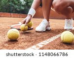tennis is her life. cropped... | Shutterstock . vector #1148066786