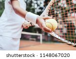 child learning to play tennis... | Shutterstock . vector #1148067020
