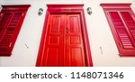 the wooden red door and windows ... | Shutterstock . vector #1148071346