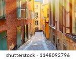 the narrow cobblestone street... | Shutterstock . vector #1148092796