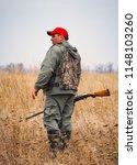 hunter moving with shotgun...   Shutterstock . vector #1148103260