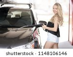 a blonde woman washing a suv car | Shutterstock . vector #1148106146