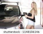a blonde woman washing a suv car | Shutterstock . vector #1148106146