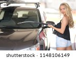 a blonde woman washing a suv car | Shutterstock . vector #1148106149