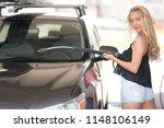 a blonde woman washing a suv car | Shutterstock . vector #1148106149