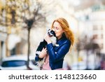 a young redhaired caucasian... | Shutterstock . vector #1148123660