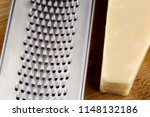 grater and parmesan cheese on a ... | Shutterstock . vector #1148132186