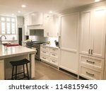 Stock photo white kitchen design with glass cabinet kitchen island with granite or marble or quartz counter 1148159450