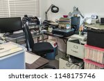 messy business office desk with ... | Shutterstock . vector #1148175746