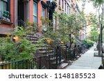 empty sidewalk in front of... | Shutterstock . vector #1148185523
