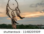 dream catcher on the sunset... | Shutterstock . vector #1148205509