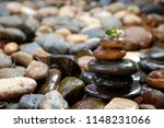stone cairn on blurry... | Shutterstock . vector #1148231066