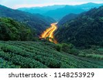 scenery of a highway winding  ... | Shutterstock . vector #1148253929