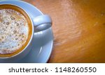 cup of hot latte coffee on... | Shutterstock . vector #1148260550