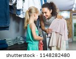 cheerful young woman selecting... | Shutterstock . vector #1148282480