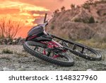 red mountain bike on the ground ...   Shutterstock . vector #1148327960