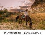 horseback riding through the... | Shutterstock . vector #1148333936