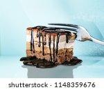 tasty tiramisu cake on desk | Shutterstock . vector #1148359676