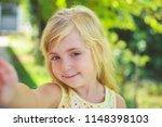 beautiful girl taken pictures... | Shutterstock . vector #1148398103