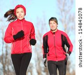 Healthy lifestyle winter running. Runner couple jogging in city park in warm winter sports clothing. Fit Asian woman fitness model and Caucasian man model. - stock photo