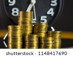 coins stacks and alarm clock in ... | Shutterstock . vector #1148417690